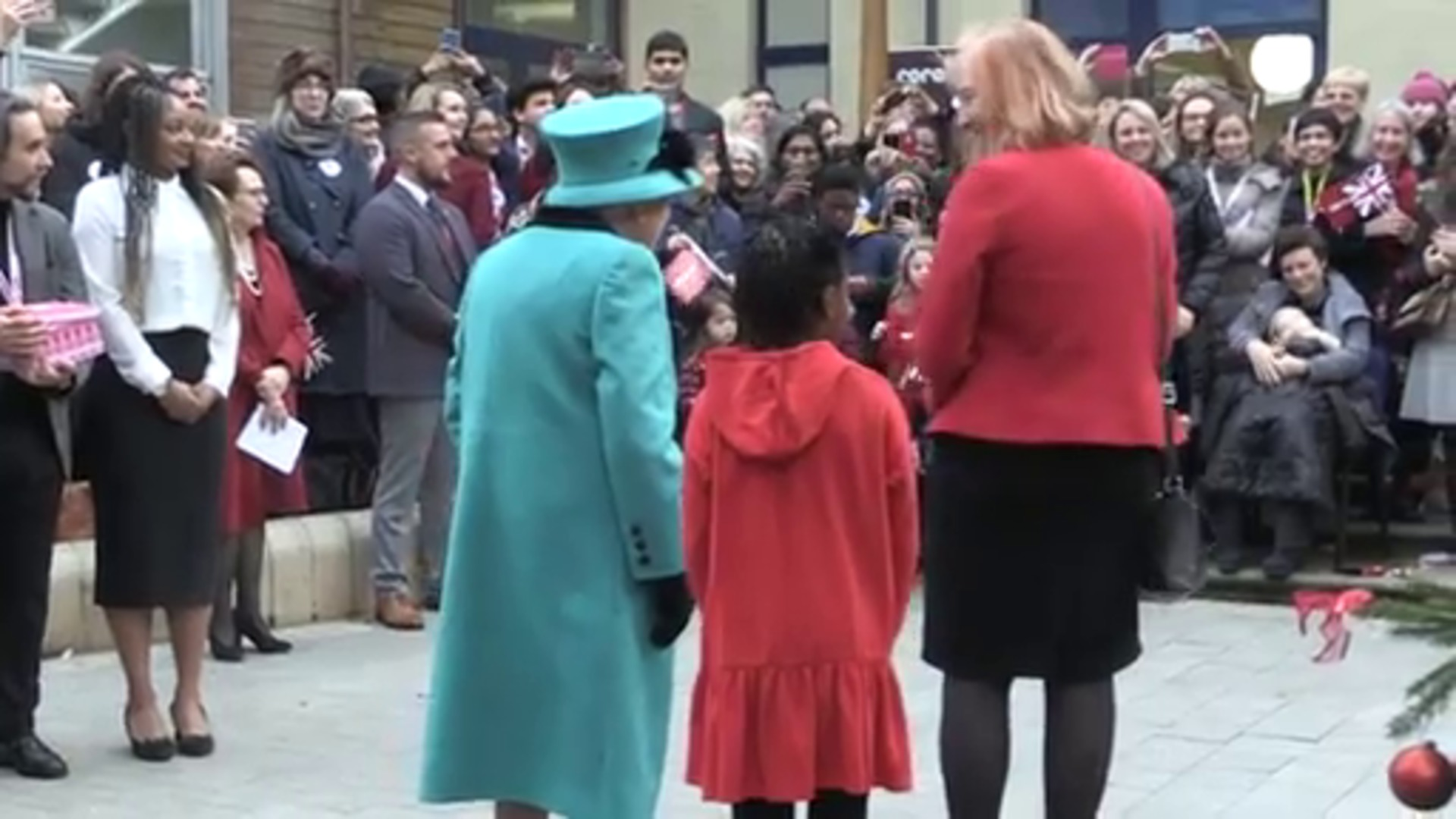 WATCH: The Queen helps little girl decorate Christmas tree