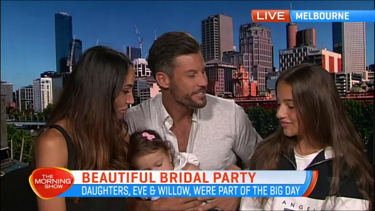 Newlywed Bachelor couple Sam and Snez battle with energetic baby girl during TV show segment