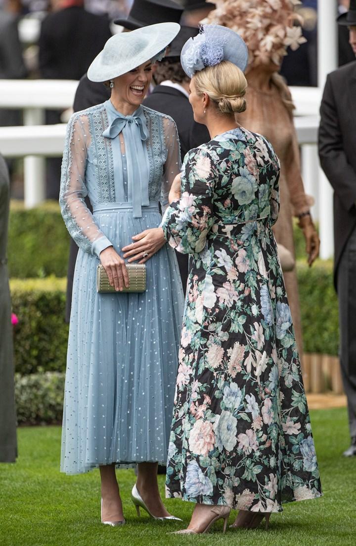 Kate Middleton pregnancy joy as she cradles belly at Ascot