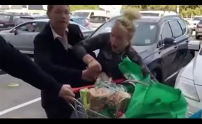'Aggressive' woman stealing a trolley of groceries fights against employee
