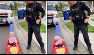 A 10-month-old toddler gets pulled over by her police officer father.