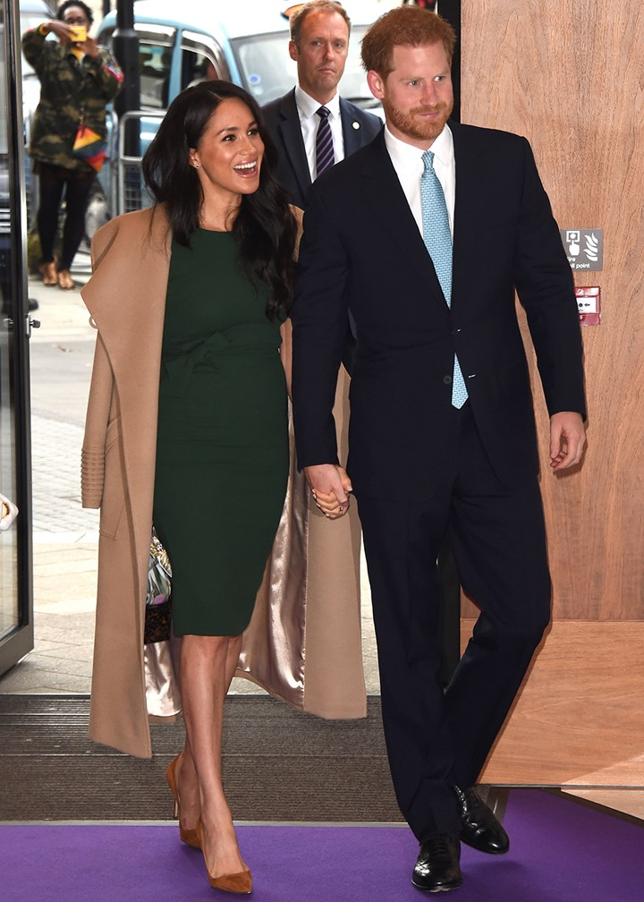 Prince Harry and Meghan Markle hold hands at emotional event